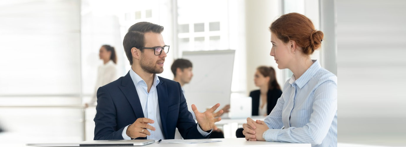 male mentor disc training talking with the employee